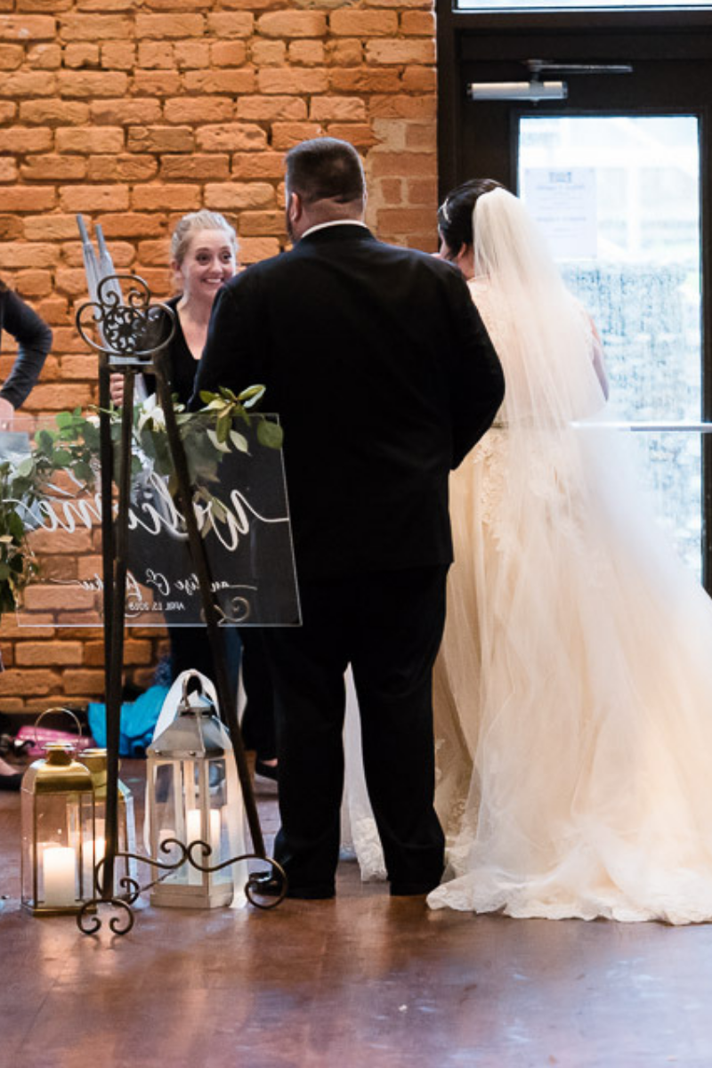 Even when I'm soaked from the rain, I am SO THRILLED for my clients.  Photographer:  Josh Jones