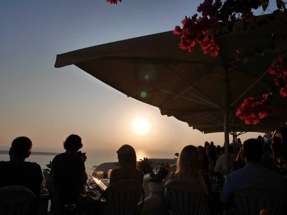crowded restaurant to watch the sunset in Oia