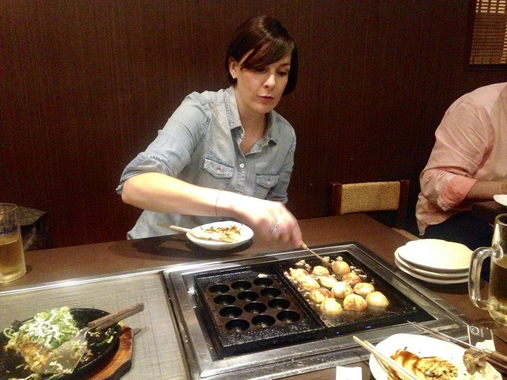 Kyoto, Japan eating Takoyaki