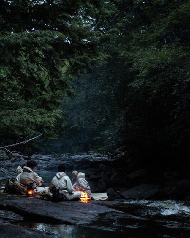 """The team spends a night close to a river, camped near rapids - their lamps like fireflies reflecting in the water."" 🌿Flora🌿 written by Sasha Louis Vukovic #comingsoon #florathemovie #millcreekentertainment"