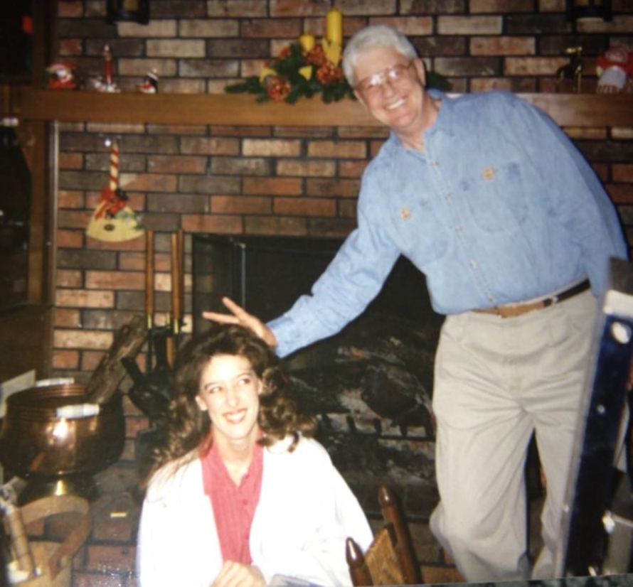 Elizabeth and her prankster dad in the 90s