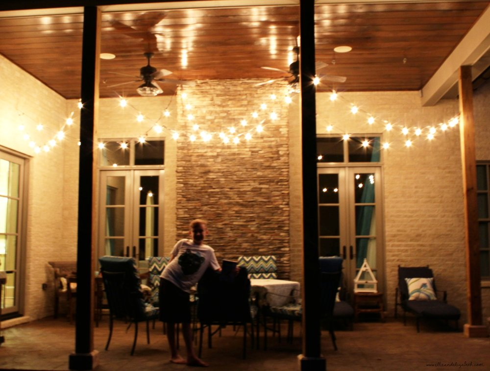 The back porch, the night of the surprise...before the fall flowers were added. Bear popped in the pic, reminding me that he also helped with the secret light surprise. He still reminds me every other day.