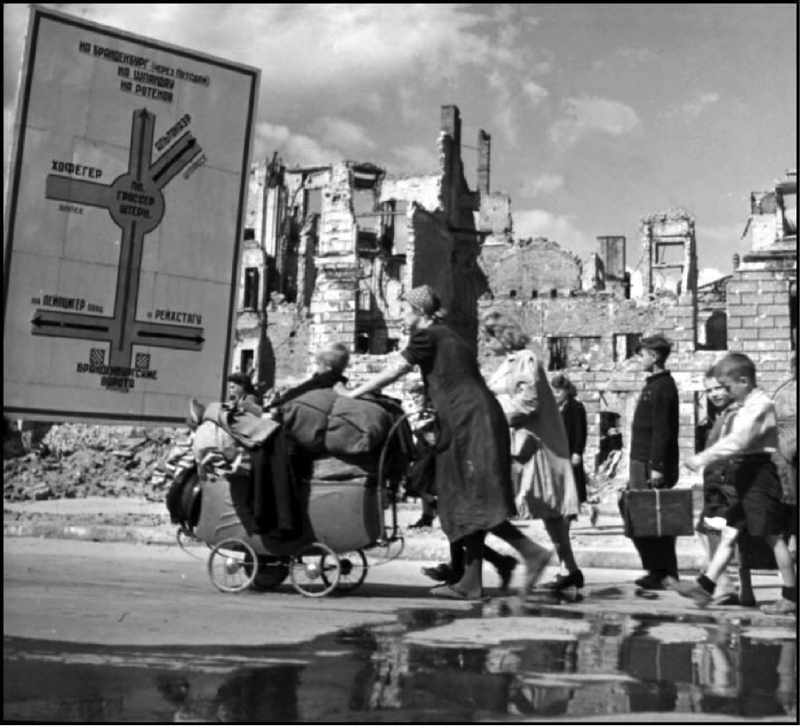 Robert Capa © International Center Berlin. 1945. Refugees making their way through the ruined Soviet sector.