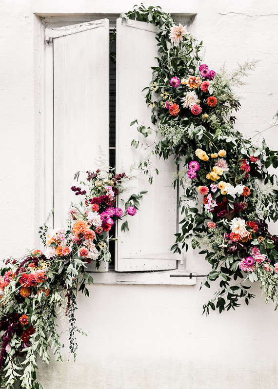 1. bold blooms - Subtlety is not your friend. Break out your rainbow palette and think outside the box, whether that's a fabulous ombre ceremony arch, or flower bombing the literal crap outta whatever you can get your hands on. For more of an impact create a juxtaposition, pair your florals with something unexpected for an eye catching installation.Image by: Megan Mcgreevy
