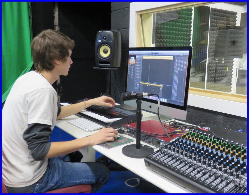 Matt at mixing board.jpg