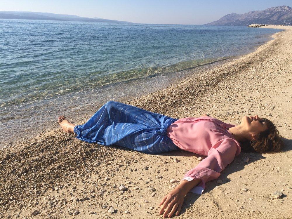 Rose quartz and serenity, alone near the sea