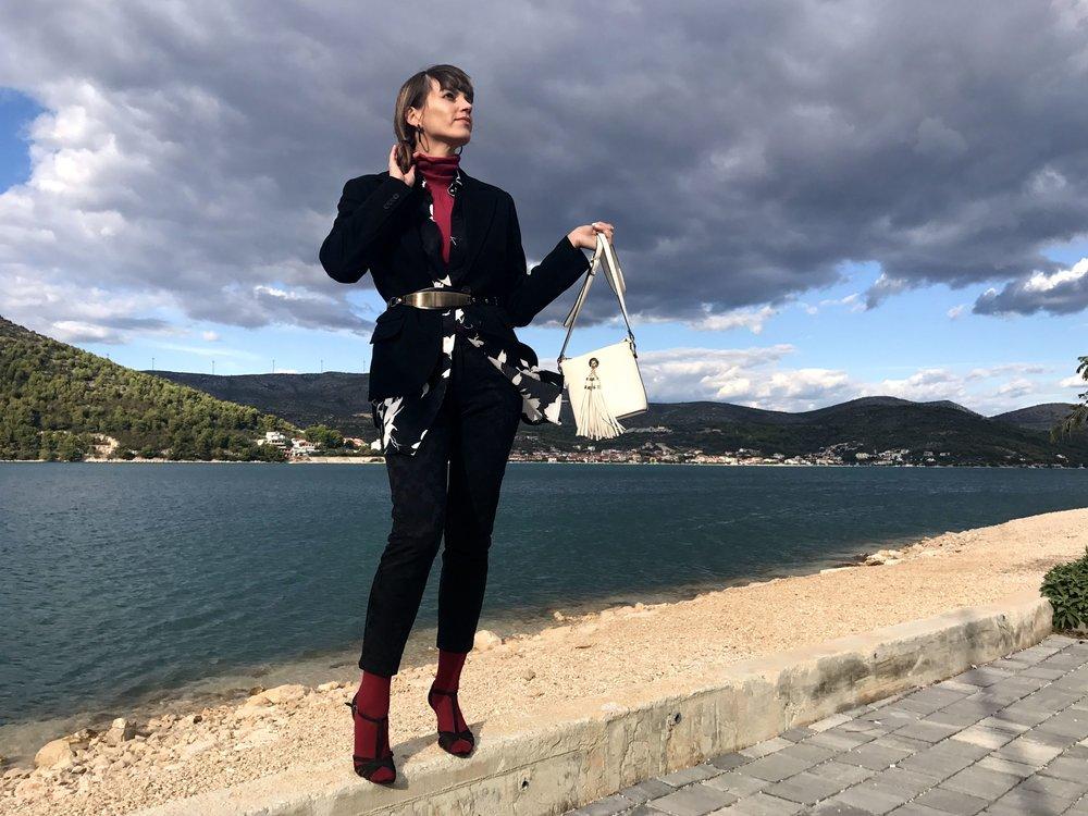 Mediterranean layering: cropped pants, turtleneck, summer button down dress, jacket, belt, socks, summer sandals