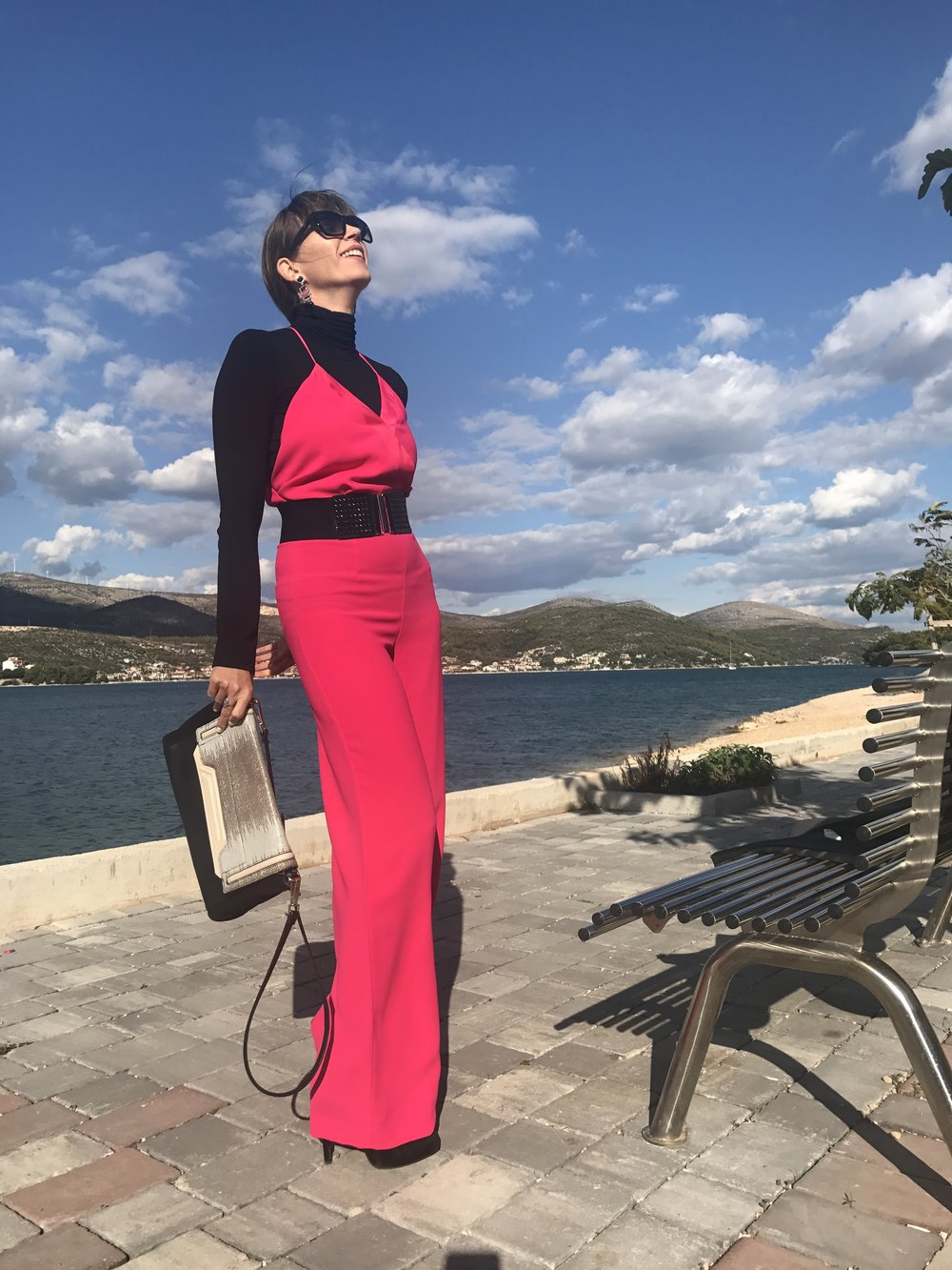 Another Vogue editorial: jumpsuit, turtleneck, belt, jewellery