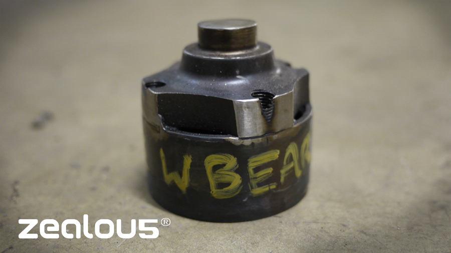 We create a tool by welding an old non Nissan wheel bearing (2mm smaller diameter) to a Renault Clio stub axle , this made pushing front wheel bearings out a snip!