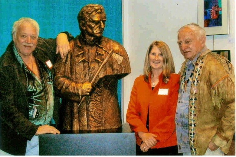 Sculptor Lorenzo Ghiglieri and Kathy Bridges from the Bridges Foundation present the bronze to Wilbur Ternyik at a Florence celebration held in April.  The bronze will be permanently mounted on 120-year old Douglas fir pedestal at its final destination, Gateway to Discovery north of Seaside.