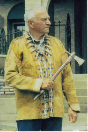 Wilbur E. Ternyik, whose ancestors were Clatsop Indians, wearing his buckskin jacket and carrying his tomahawk.
