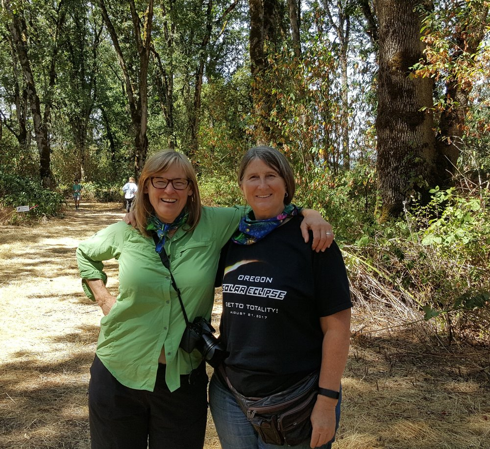 august 21, 2017 -- Enjoying the eclipse event in oak haven with audubon society of Oregon (Jane hartline (left) and kathy bridges, the bridges foundation
