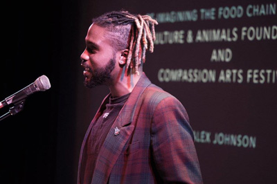 Donald Vincent  (aka Mr. Hip Presents: Reading Series) performs his poems at the Compassion Arts & Culture and Animals Festival, October 22, 2017. Photo by Jo-Anne McArthur