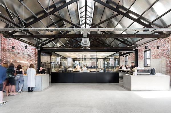Lune Croissanterie - a functional, sleek and customer-centric space that highlights the process of pastry making to form an eye-catching experience without impacting the use of the space (image via A friend of Mine)
