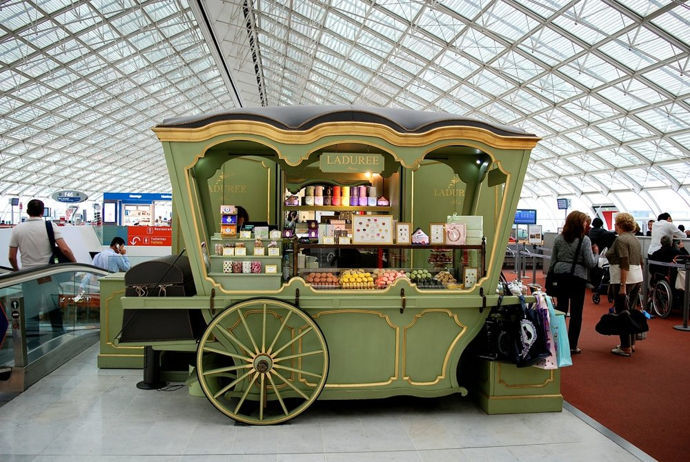 Laduree's pop-up cart at Charles de Gaulle Airport capturing the customer group in transit (  image via Weekend in Paris  )