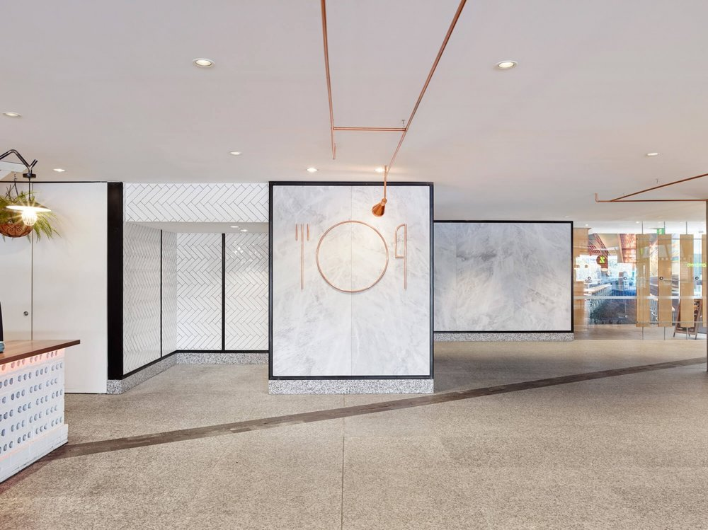 The entry to Riverside Food Court in Brisbane, Australia  image via identity and signage designer Tony Gooley