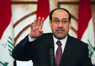 Above: Maliki counting to four