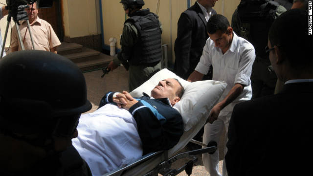 Former Egyptian President Hosni Mubarak, seen here playing dead at his own trial.