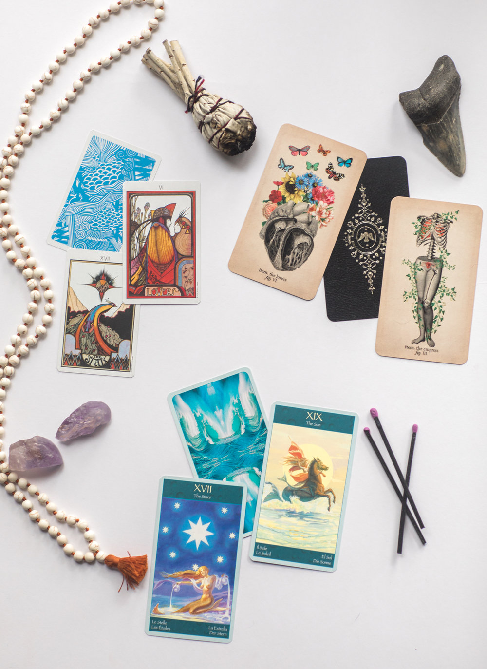 Clockwise from top left:  Aquarian Tarot Deck ,  Antique Anatomy Tarot by Black and the Moon ,  Mermaid Tarot Deck