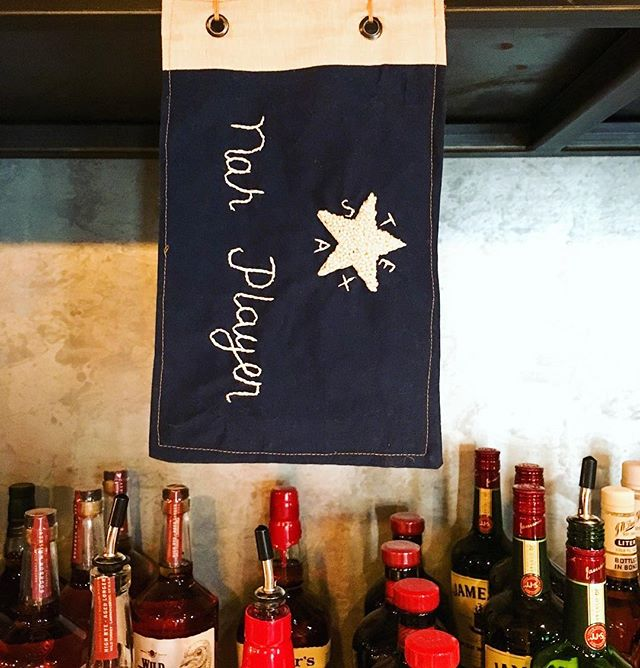 When someone leaves you a hilarious one star review of your bar, you commemorate it in a republic of Texas flag.