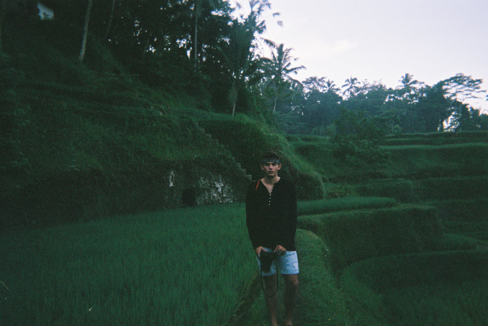 This is at the tegalalang rice terraces in Ubud. Go early before the sun rises if you want an out of body experience. Seriously, this is in my top 5 places I've ever visited. It will knock you riiight over.