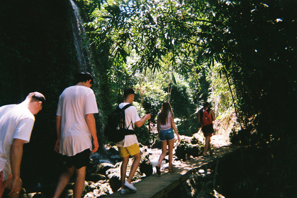 Hiking to the Tibumana waterfall. Peep jacksons camera set up hahaha the boy DOES. NOT. REST.