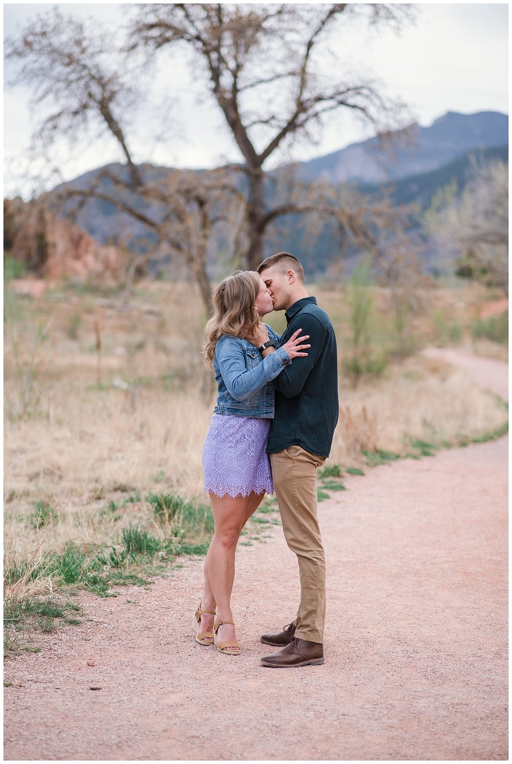 Engagement Photos, Couple Walking down Pathway, Purple Dress Engagement Outfit, Military Couple, Red Rocks Open Space Engagement Session, Colorado Engagement Photographer, Colorado Wedding Photographer, Denver Engagement Photographer, Denver Wedding Photographer, Colorado Elopement Photographer, Denver Elopement Photographer, Rocky Mountain Elopement Photographer, Best Denver Photographer, Best Colorado Photographer, Colorado Fine Art Photographer, Colorado Springs Engagement,