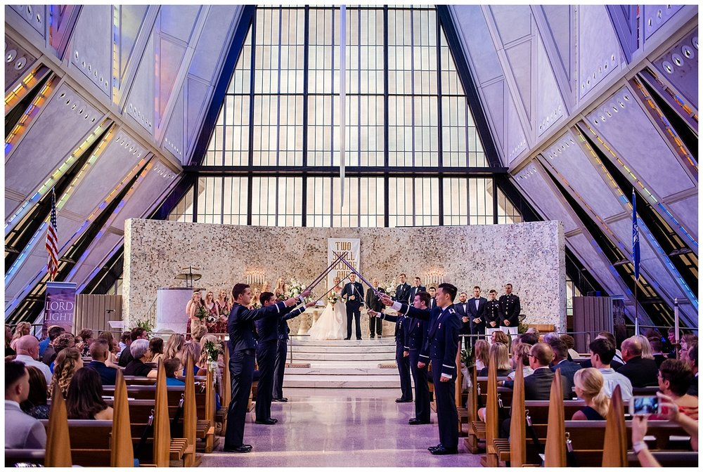 Military Wedding, Cadet Chapel Wedding, bride and groom first kiss, navy suits, dress blues, sparkly red bridesmaids dresses, Colorado Wedding Photographer, Denver Wedding Photographer, Denver Elopement Photographer, Colorado Elopement Photographer, Rocky Mountain Wedding Photographer, Downtown Denver Photographer