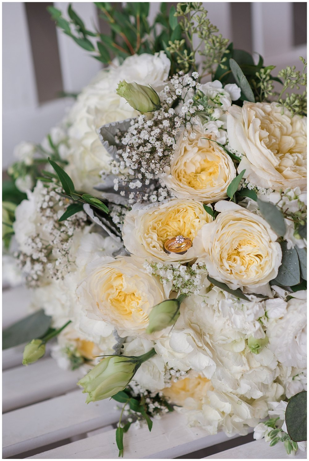 Yellow and green floral details at wedding in the barn at raccoon creek, colorado wedding photographer, denver wedding photographer, colorado elopement photographer,