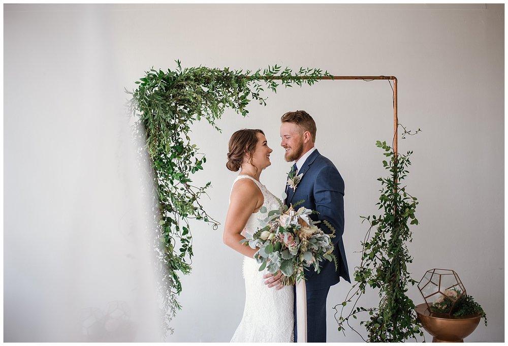 bride and groom portraits in a metal tones and pink wedding, eucalyptus wedding decor, downtown denver wedding photographer, estes park wedding photographer, colorado wedding photographer,