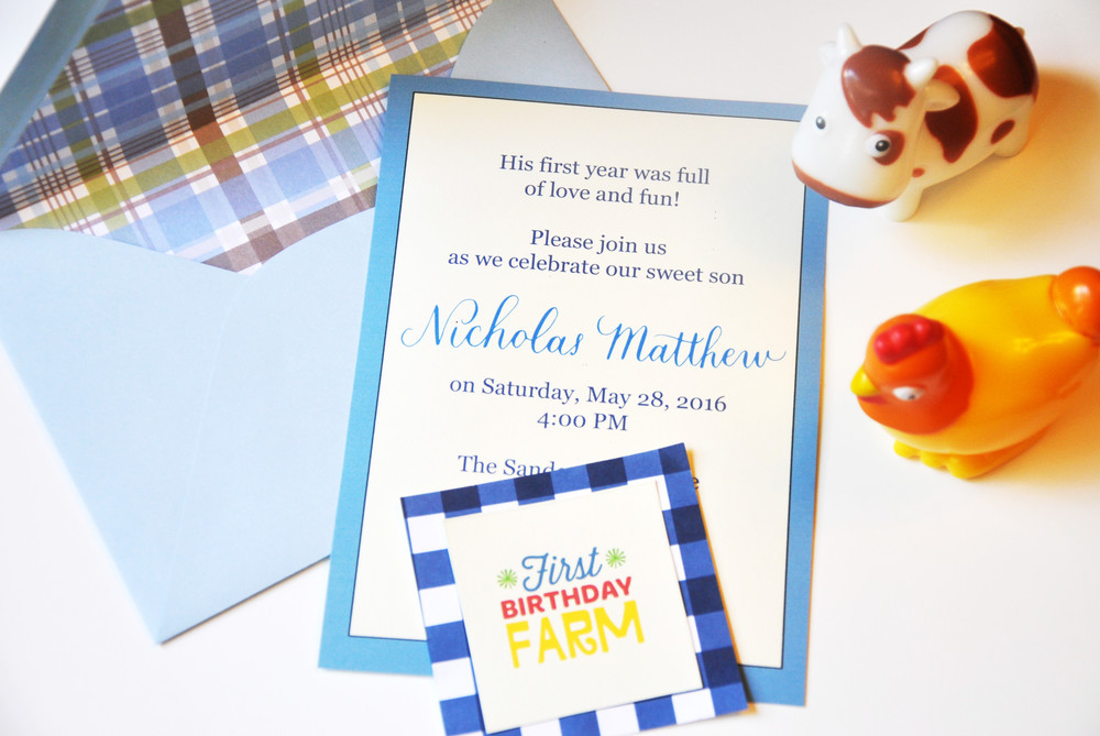 The invitation included simple script and type printed on ivory Papersource cardstock and light blue Papersource envelopes that I lined with cute scrapbook paper.  The printable is from Fisher-Price's website. The printables were used as cake toppers and centerpieces.