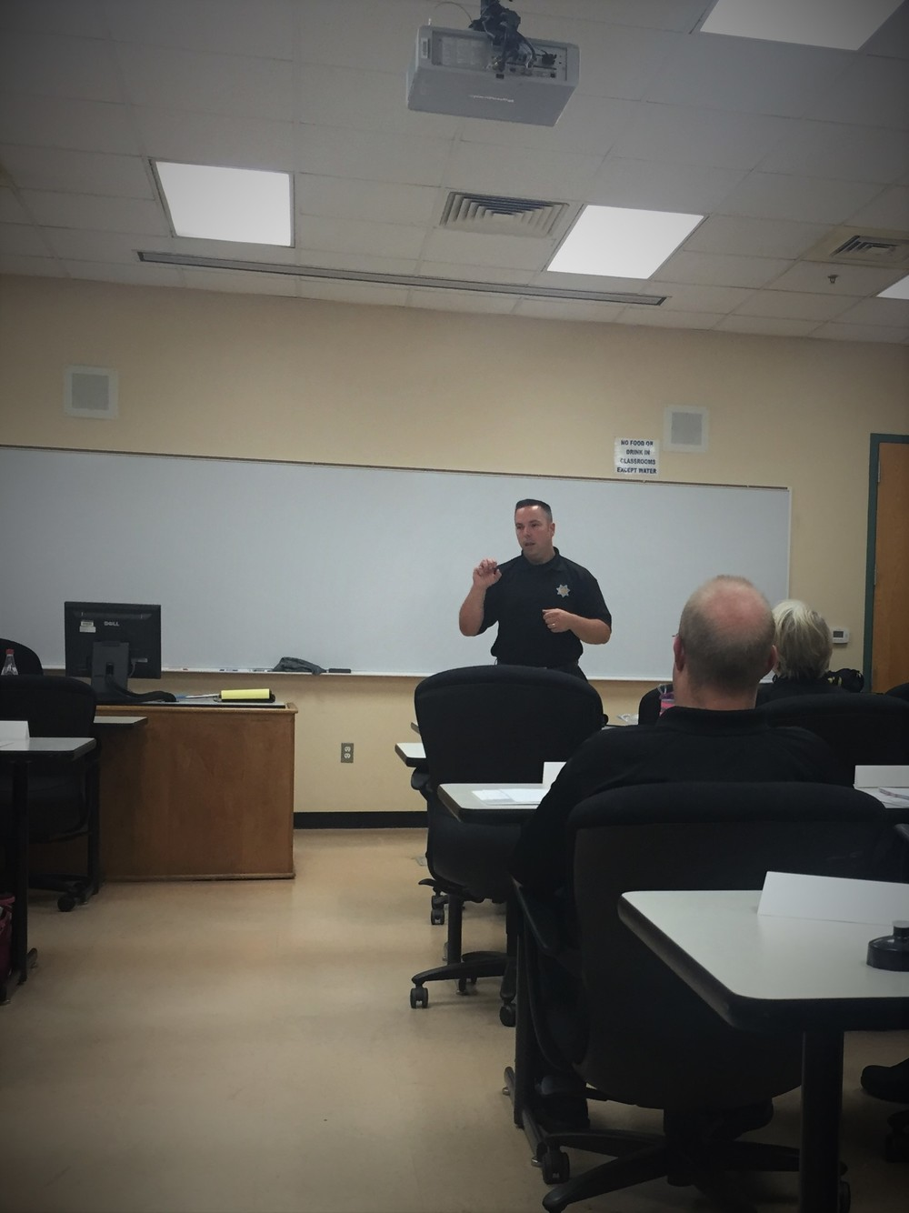 Officer J. Crespan with Santa Rosa Police Department teaching a class on law enforcement culture.