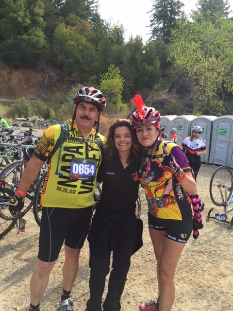 Chaplain Christine Buetera-Ortiz at a rest stop with two Tour de Fuzz riders.