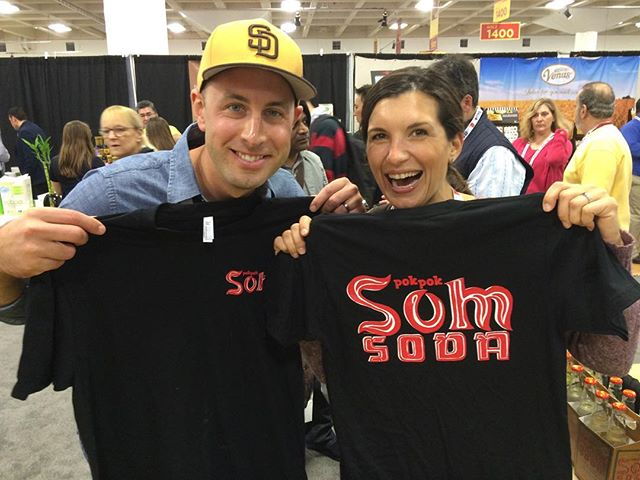 """We're giving away some new Som Soda tees at @craftcarejoy #WFFS16. Just come to booth 1273 and whisper """"Ike's Chicken Wings"""" to Dylan to get one!"""
