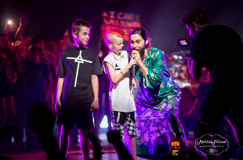 Jared Leto brings a couple young fans on stage to sing.