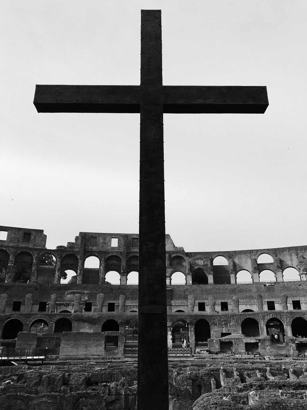 ÎRØN CRØSS - I've always loved learning about the history of the Roman Empire. Thanks to my job, I was able to travel to Rome and saw many of the historic sites. As a Christian, seeing this cross inside the Colosseum as a memorial to the martyrs who were probably sacrificed for Christ's sake was very moving.