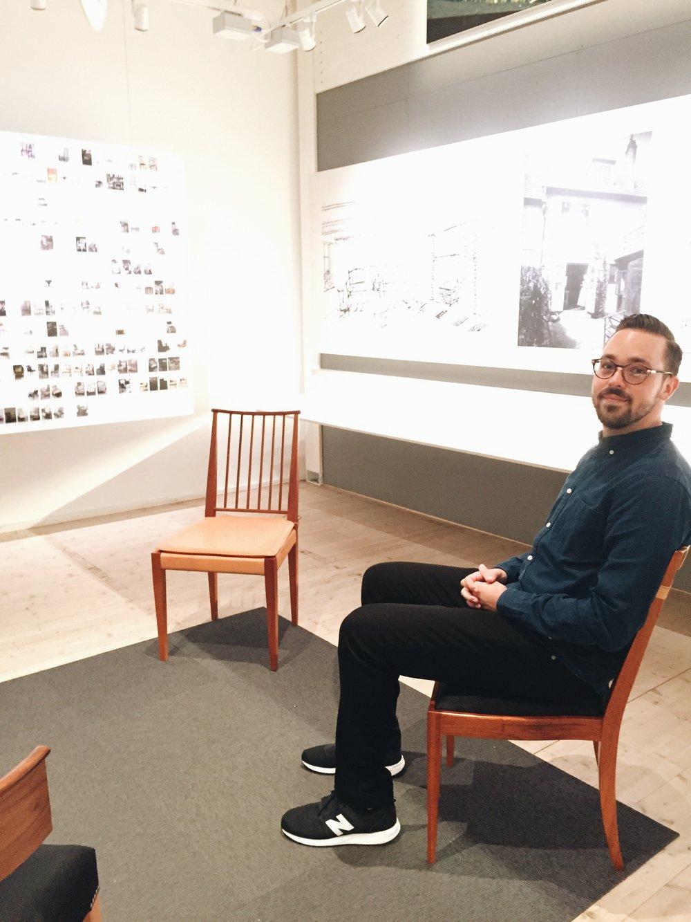 Scott testing Scandinavian furniture at the Josef Frank exhibit.
