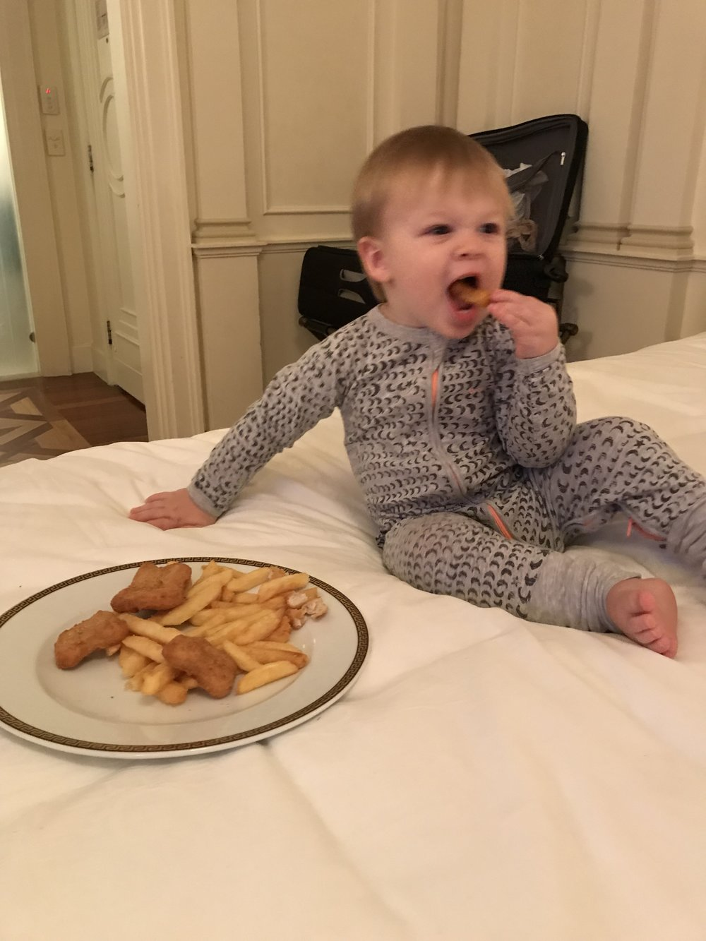 Living his Best Life: chicken nuggets and chips in bed!