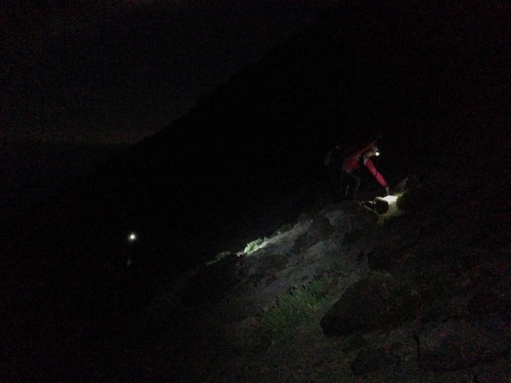 Heading up at midnight via headlamp.