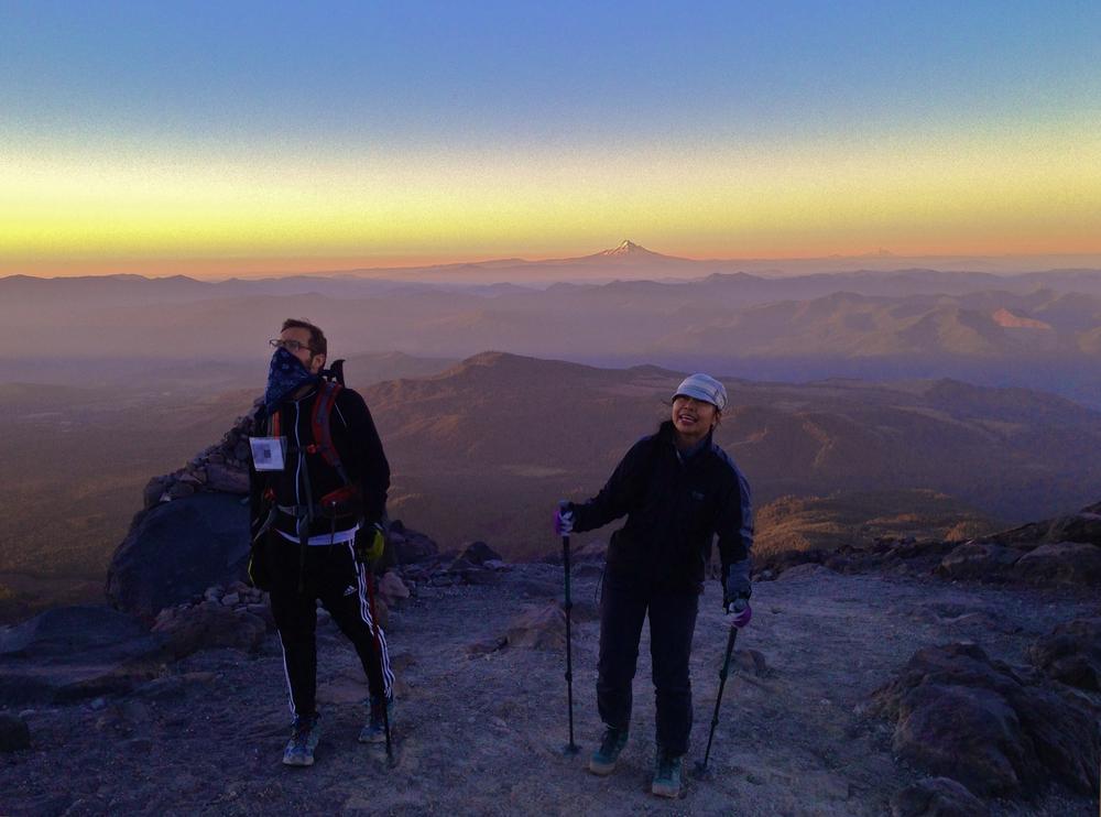 Reaction shots:Sunrise reveals the summit.