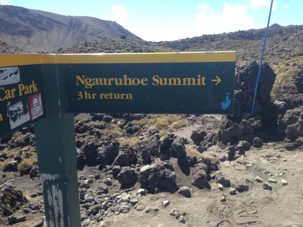 At the turnoff for Ngauruhoe, you're looking at about a three hour roundtrip from sign to summit back to sign.
