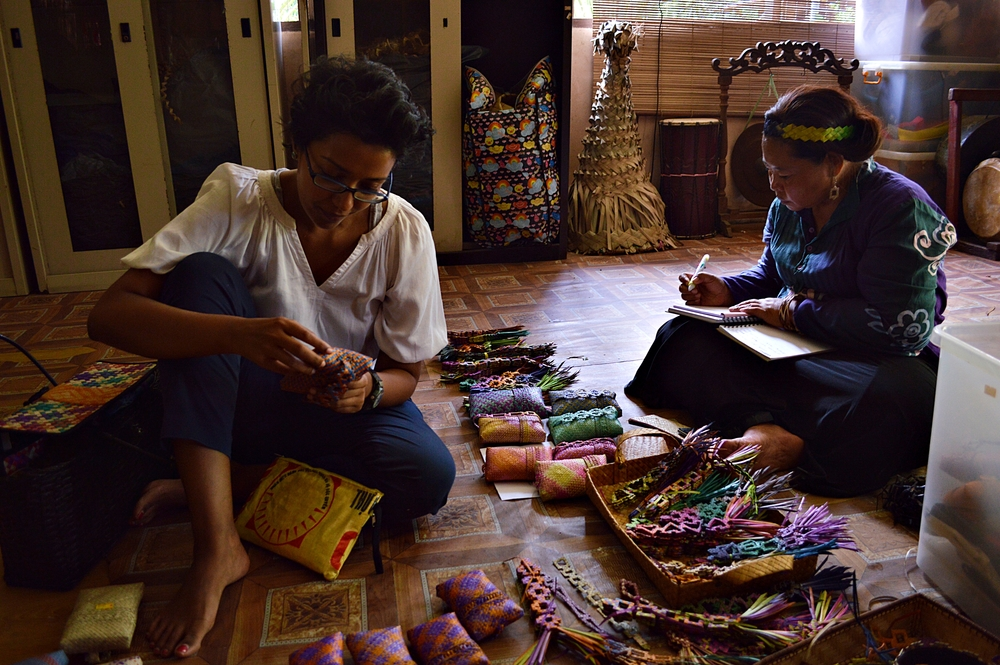 Founder of Earth Heir, Sasi, looking over some products with a woman from the Mah Meri indigenous tribe.