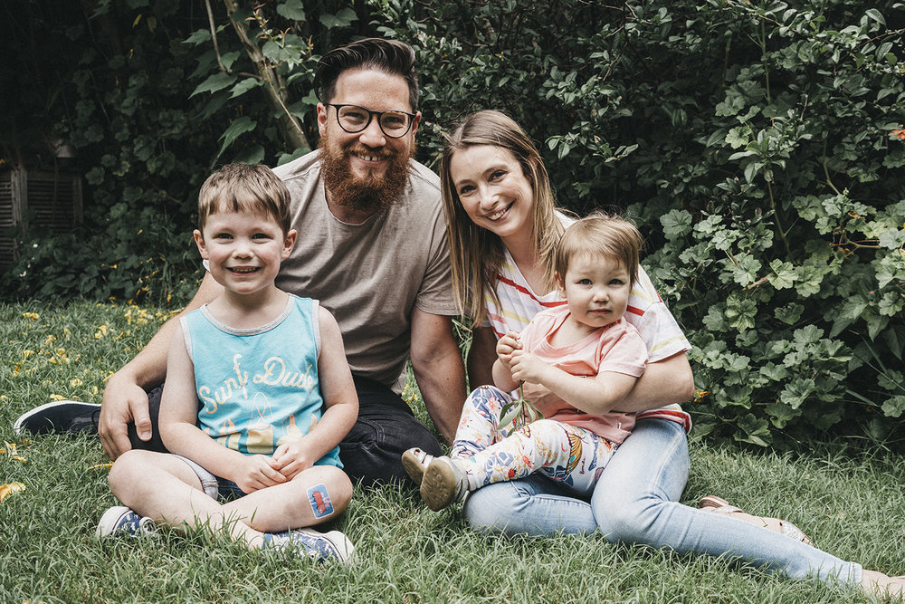 Melbourne wedding videographer Nathan Kaso sitting with his wife and kids