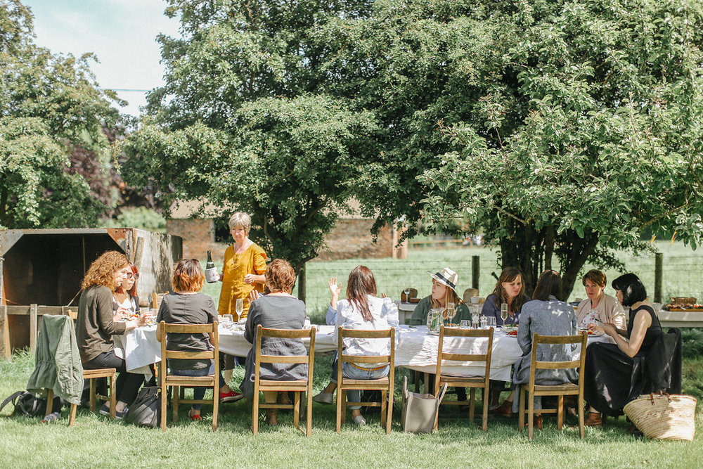 Al fresco lunch in the orchard at Holme Flowers
