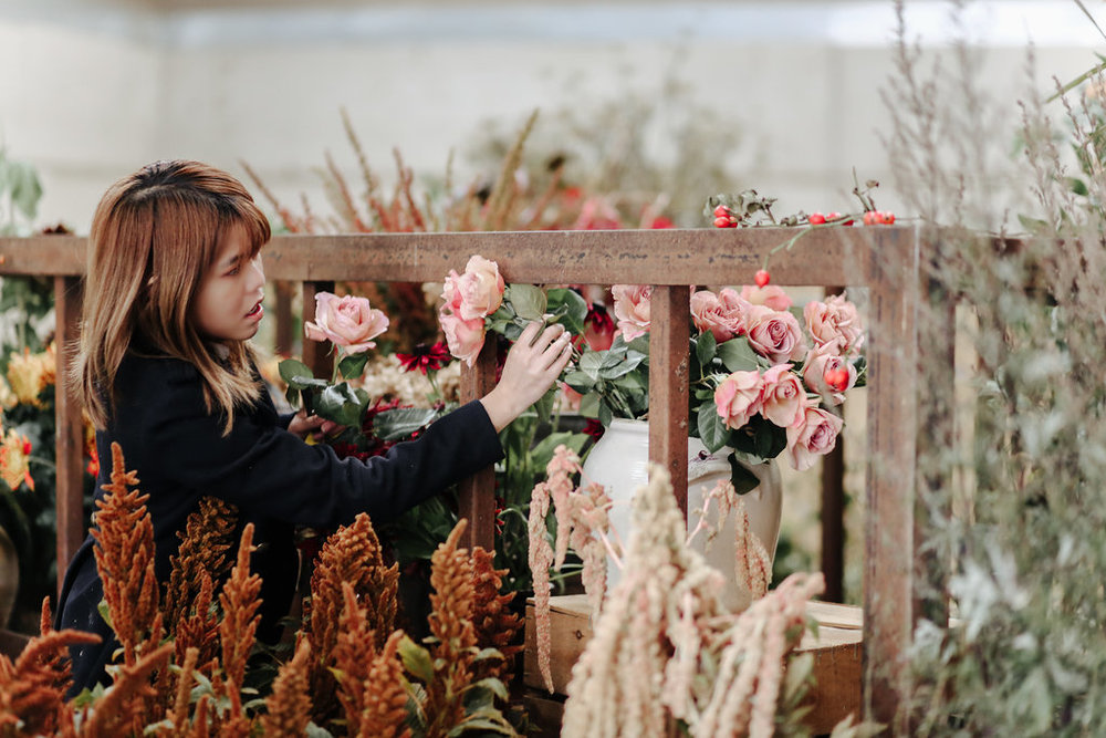 student choosing her perfect flower