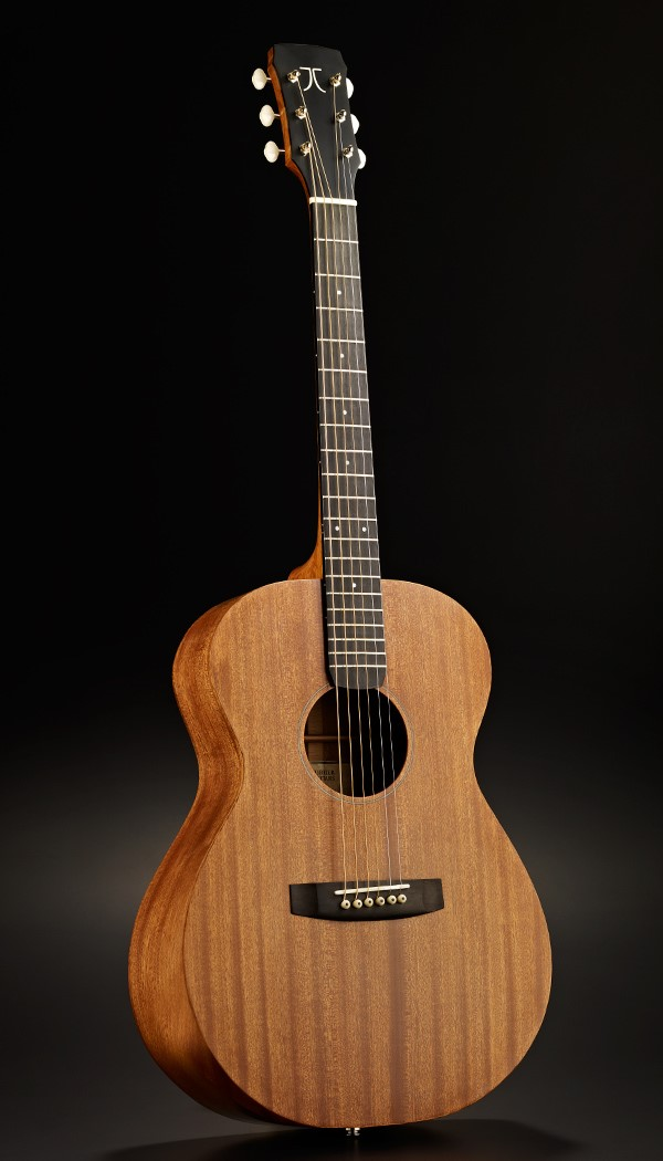The Mahogany guitar is an Amherst Model with Mahogany back,sides,and top. The neck is solid mahogany and the binding is mahogany cut from the sides. The Ryan style armrest bevel also uses a mahogany laminate from the same piece of wood from the top. The fretboard and bridge are ebony. The bridge pins are bone with a ebony dot. Scale length is 25'. Waverly Tuners.