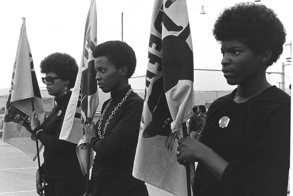 black+panthers+dogwoof+documentary+#1+Women+drilling+with+Panther+flags.+Photo+courtesy+of+Pirkle+Jones+and+Ruth-Marion+Baruch..jpg
