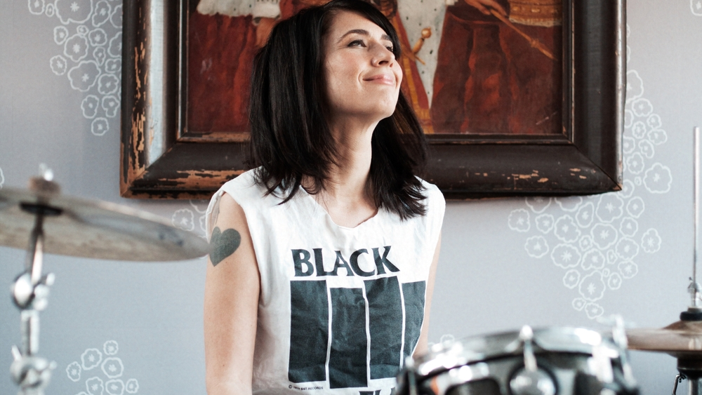 #3 - Kathleen Hanna playing the drums. Photo courtesy of Allison Michael Orenstein.jpg