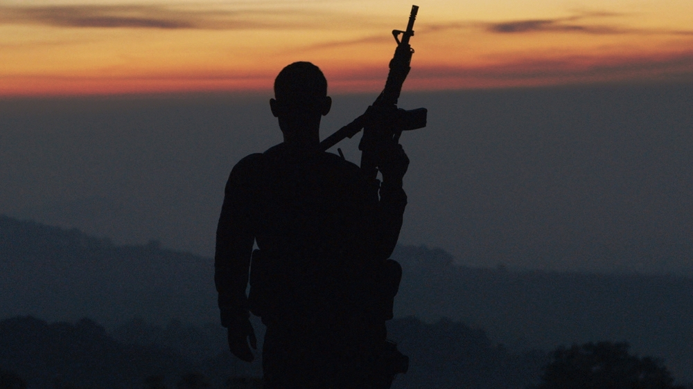 #1 - Autodefensa member standing guard in Michoacán, Mexico, from CARTEL LAND, a film by Matthew Heineman.jpg