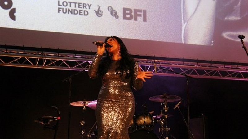 Pictured: Michelle John performing at the Whitney 'Can I Be Me' live premiere event